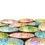Coloured coconut bowls inlaid with eggshell and gold.