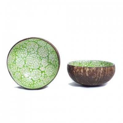 Side and inside view of green coconut bowl inlaid with eggshell.