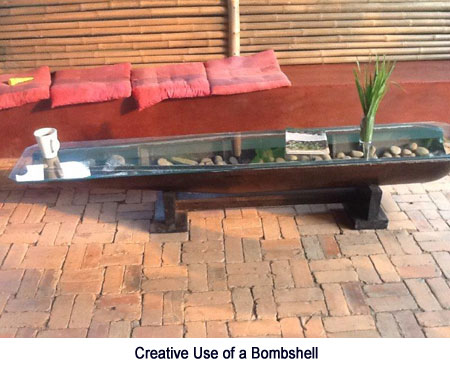 Coffee table made from a bombshell.