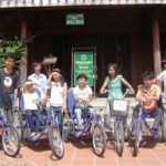 Smile House group photo with bicycles.