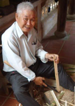 Father of Smile House working with bamboo.