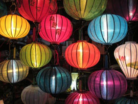 Lit up coloured silk lanterns.