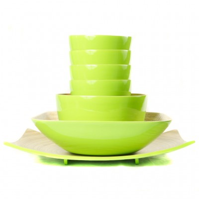 Full set of eco friendly lime green bamboo bowls in different sizes and a platter.