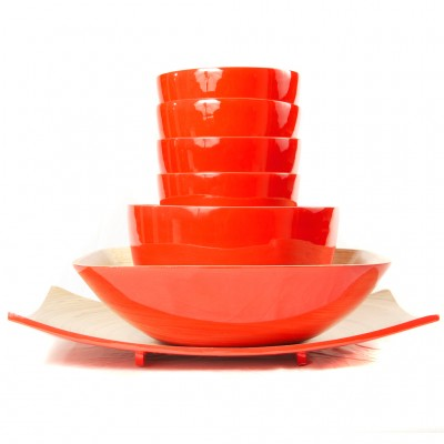 Full set of eco friendly red bamboo bowls in different sizes and a platter.